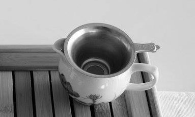 Chinese tea strainer and pitcher