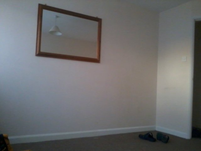 empty room mirror on wall