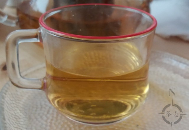 a small cup of green gunpowder tea