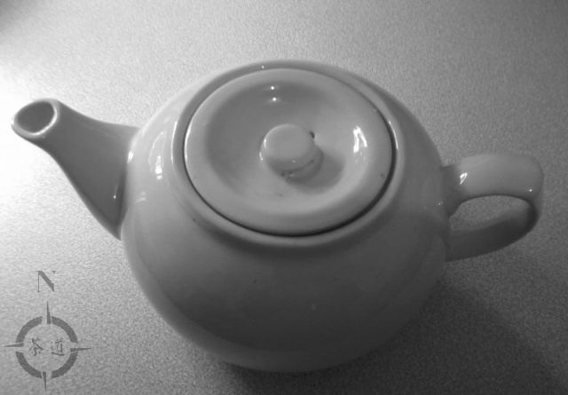 small white tea pot