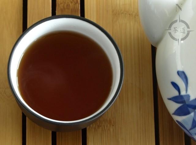a cup of mandarin peel flavoured shou Pu-erh
