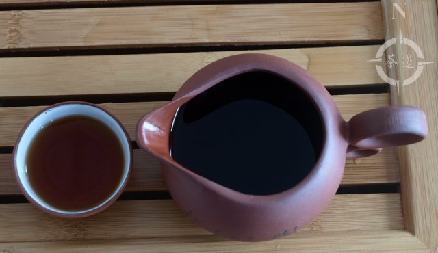 clay tea cup and tea pitcher