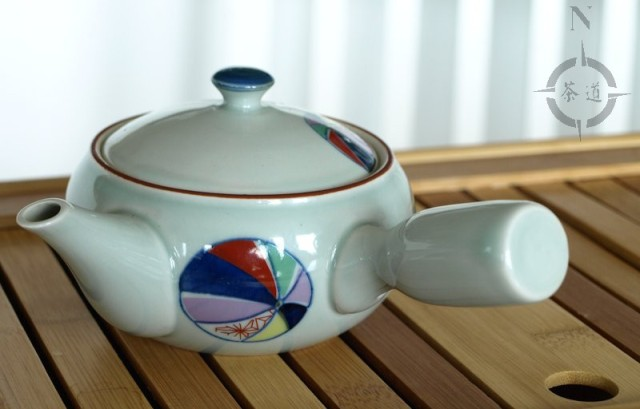 side handled teapot