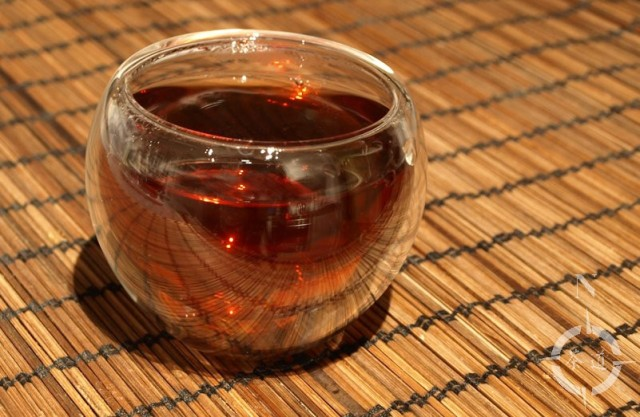 a cup of 2012 Xiaguan 7663 Cooked Beeng Cha