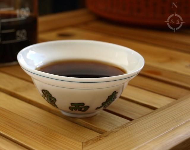 a cup of 2010 Haiwan Lao Tong Feng Shu Cha